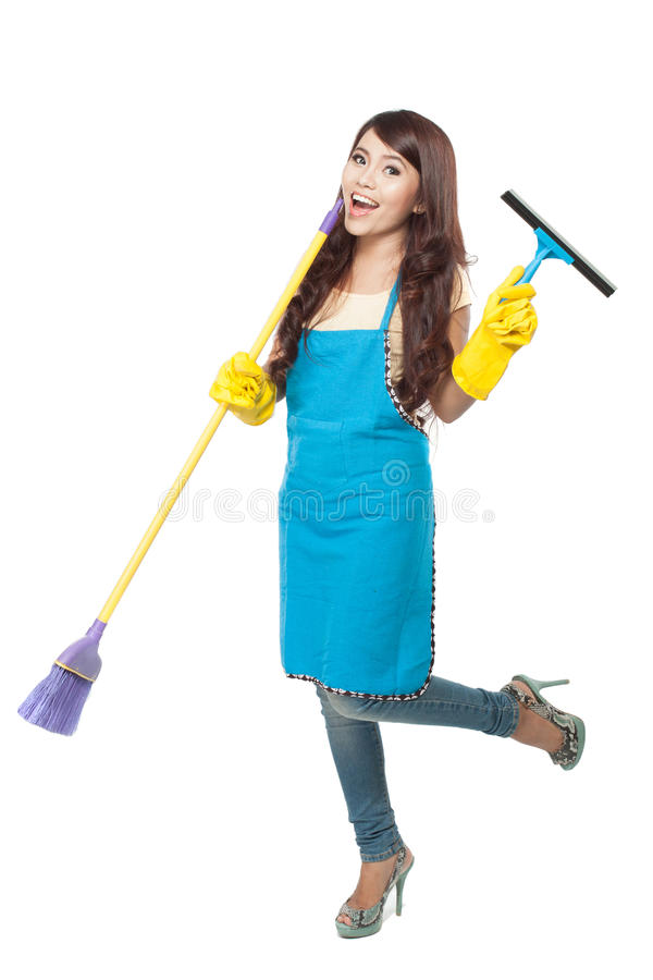 Young asian woman happily doing chores, isolated stock photography