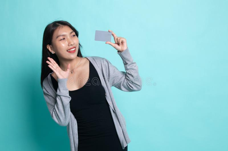 Young Asian woman happy with  blank card royalty free stock photo