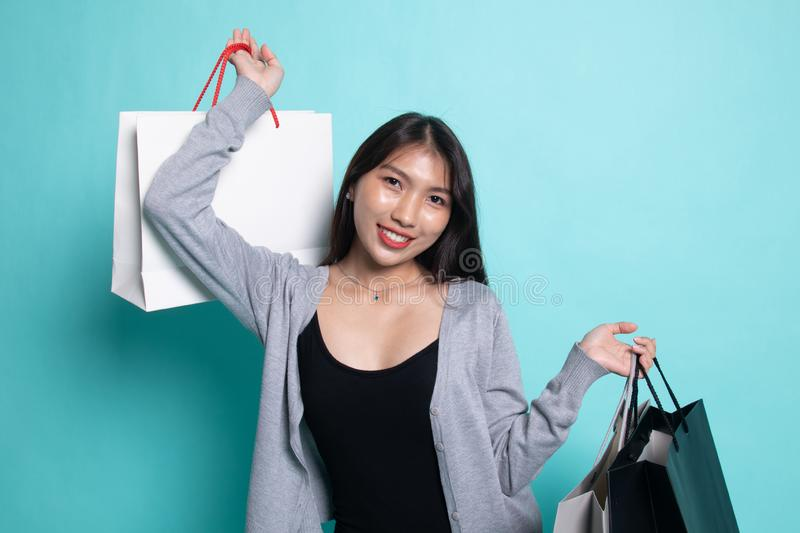 Young Asian woman happy with shopping bag stock photo