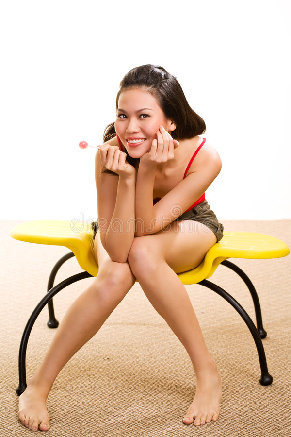 Free Young Asian Woman Having Fun With Lollipop Stock Image - 6328941