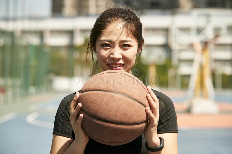 Young asian girl holding a basketball stock images