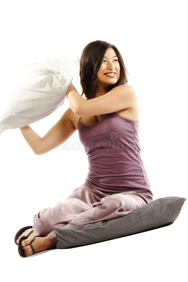 Young asian woman holding pillow stock photography