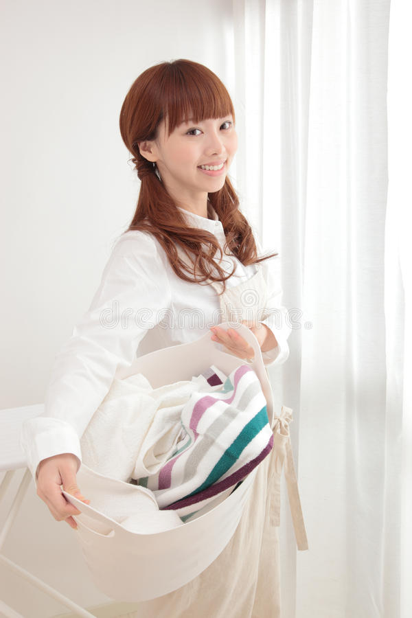 Download Young Asian Woman With Laundry Stock Photo - Image: 23523770