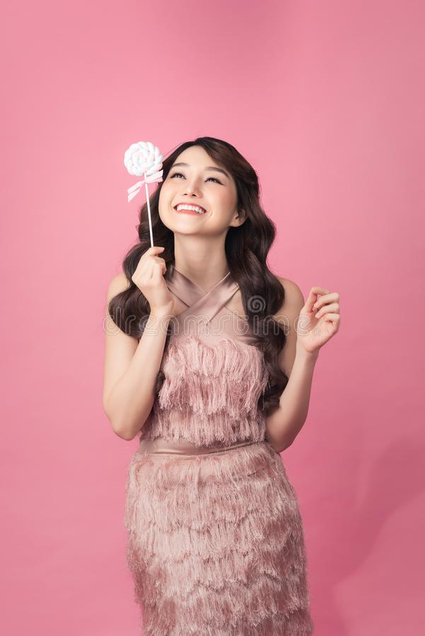 Young asian woman with lolipop royalty free stock photography