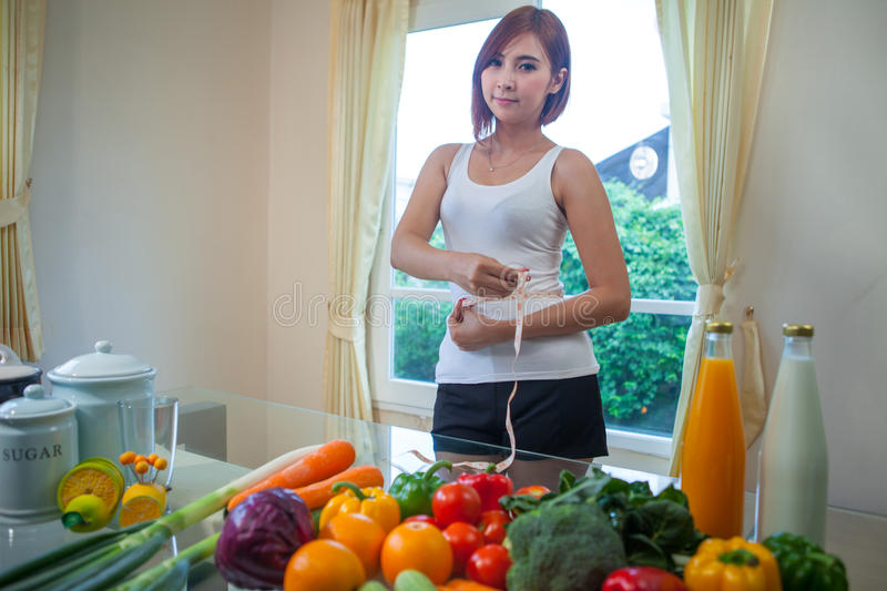 Young asian woman measuring royalty free stock photography