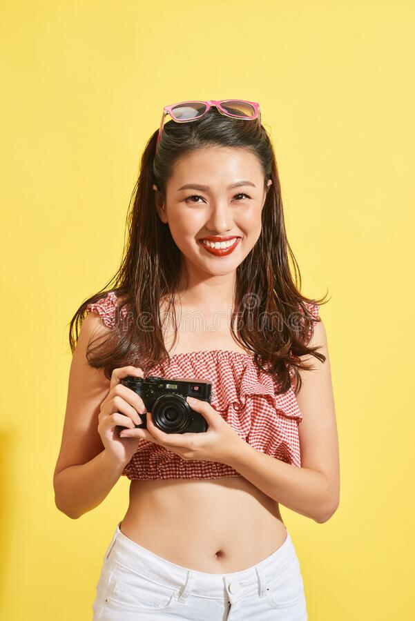 A young Asian woman photographer holding film camera.  royalty free stock photos