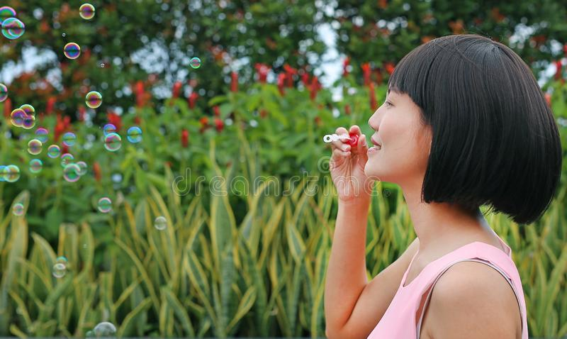 Young asian woman playing bubble outdoor stock images