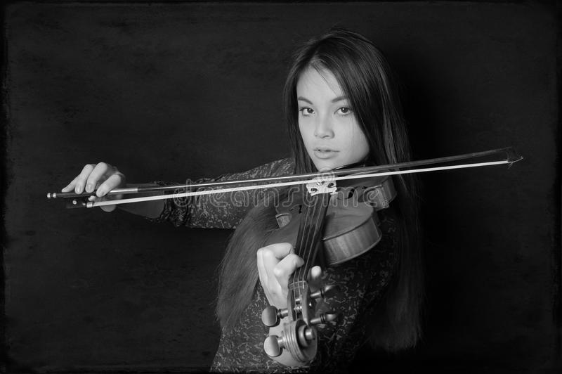 Young asian woman playing violin. In black and white stock photos