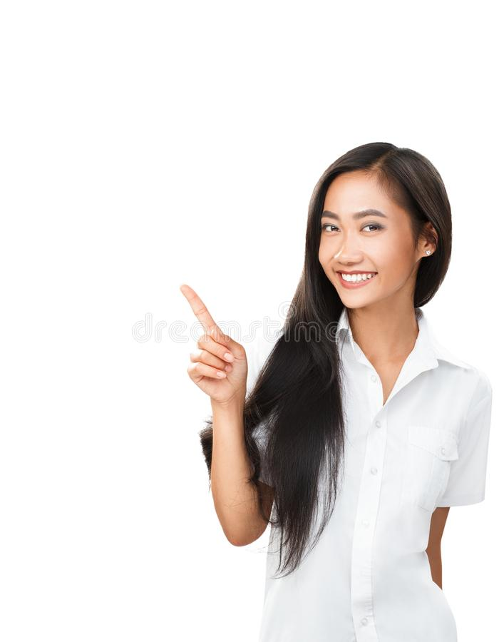 Young Asian woman pointing finger and looking in same direction. Photo for business projects, product presentation, interpersonal topics dating, flirting royalty free stock photography