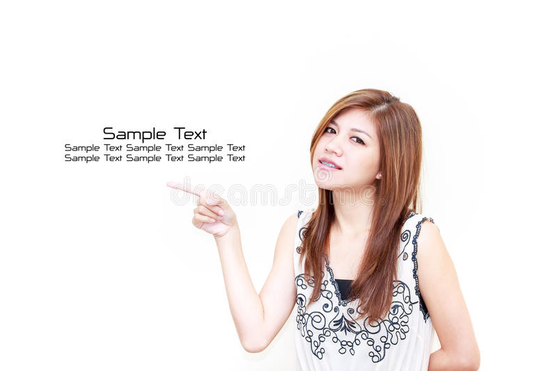 Download Young Asian Woman Pointing On White Background Stock Photo - Image: 26495072