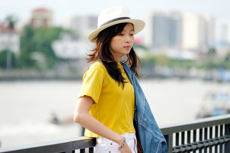 Young asian woman portrait at city outdoors background, casual lifesyle, travel blogger royalty free stock image