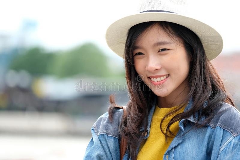 Young asian woman portrait smiling with happiness at city outdoors background, casual lifesyle, travel blogger royalty free stock photo