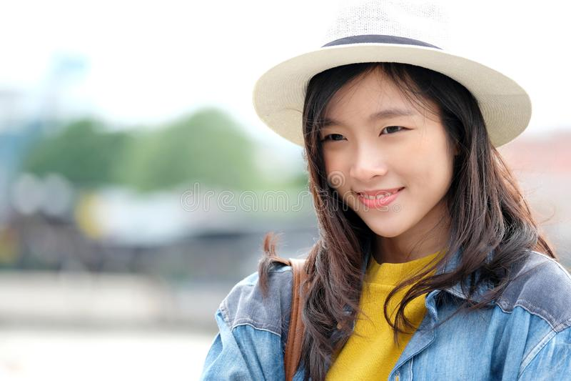 Young asian woman portrait smiling with happiness at city outdoors background, casual lifesyle, travel blogger royalty free stock images