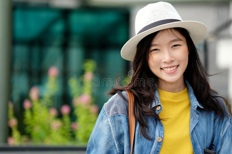 Young asian woman portrait smiling with happiness at city outdoors background, casual lifesyle, travel blogger royalty free stock image