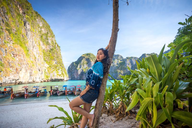 Young asian woman posting on the Maya bay royalty free stock image