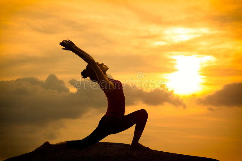 Young asian woman practicing yoga stock photo