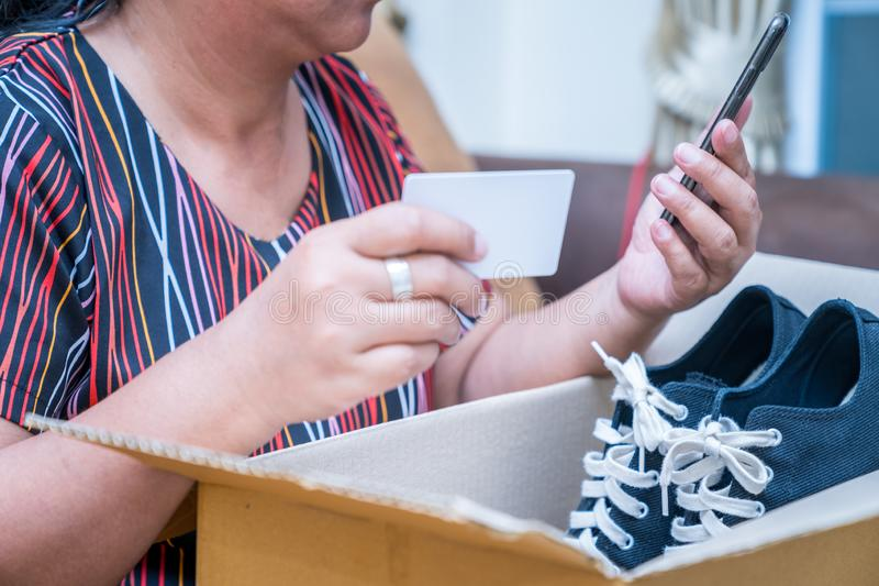 Young asian woman received online shopping parcel opening boxes royalty free stock image