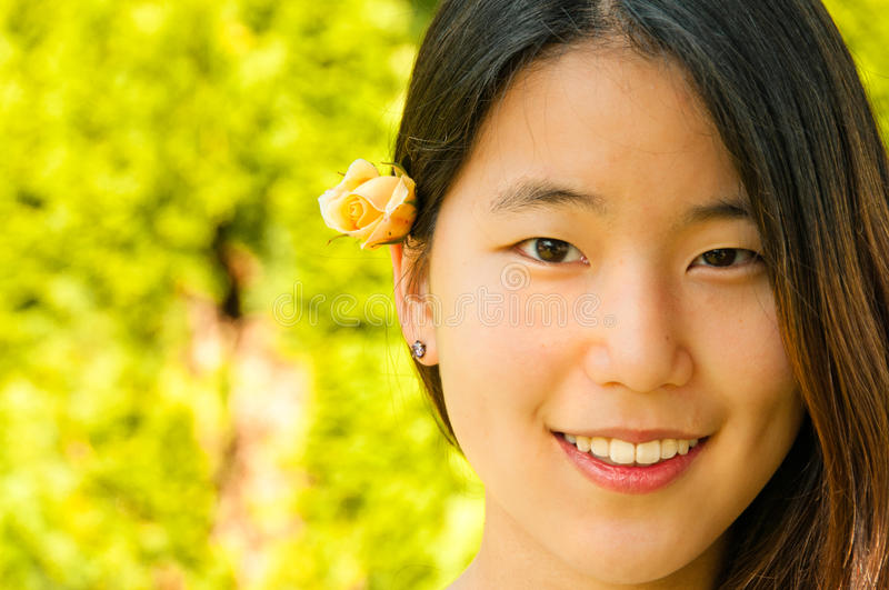 Young Asian Woman Rose Bud in Hair stock photography
