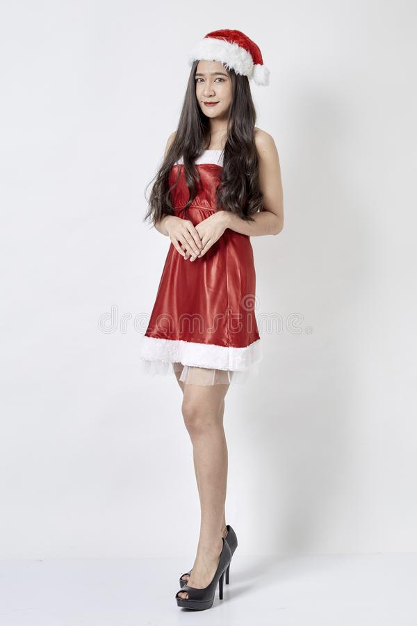 Young asian woman in Santa hat on white stock photography