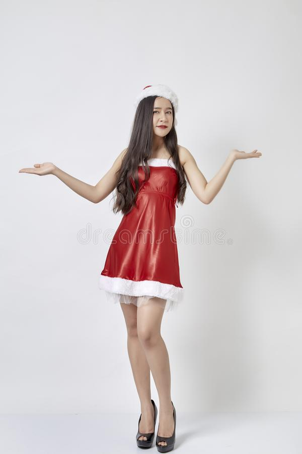 Young asian woman in Santa hat on white stock photo