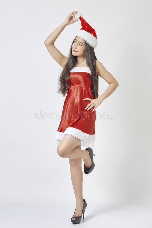Young asian woman in Santa hat on white royalty free stock photos