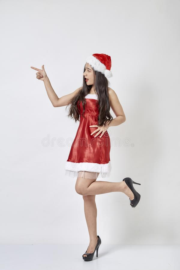 Young asian woman in Santa hat on white royalty free stock image