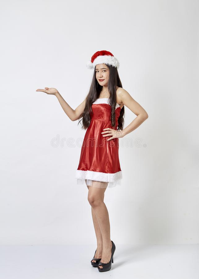 Young asian woman in Santa hat on white stock image