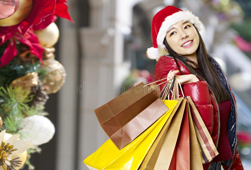Young asian woman shopping for christmas royalty free stock photography
