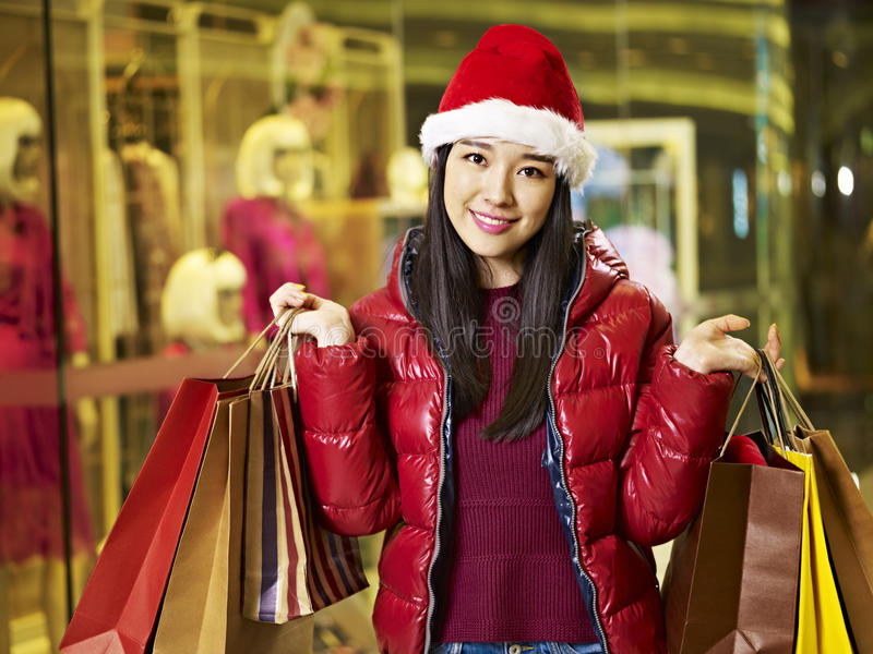 Young asian woman shopping for christmas stock photography
