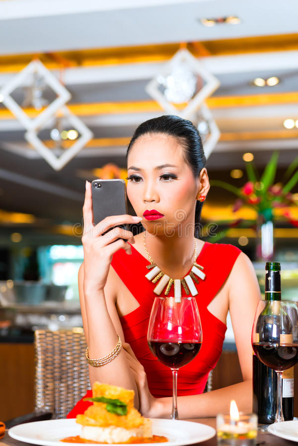 Young Asian woman sitting in restaurant stock photography