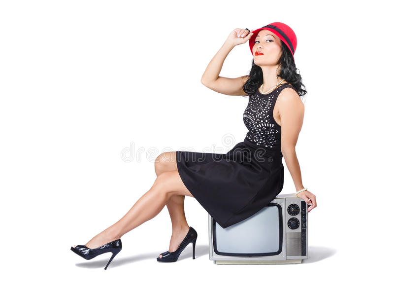 Download Young Asian Woman Sitting On 70s Tv Set Stock Photo - Image of asian, female: 32986916