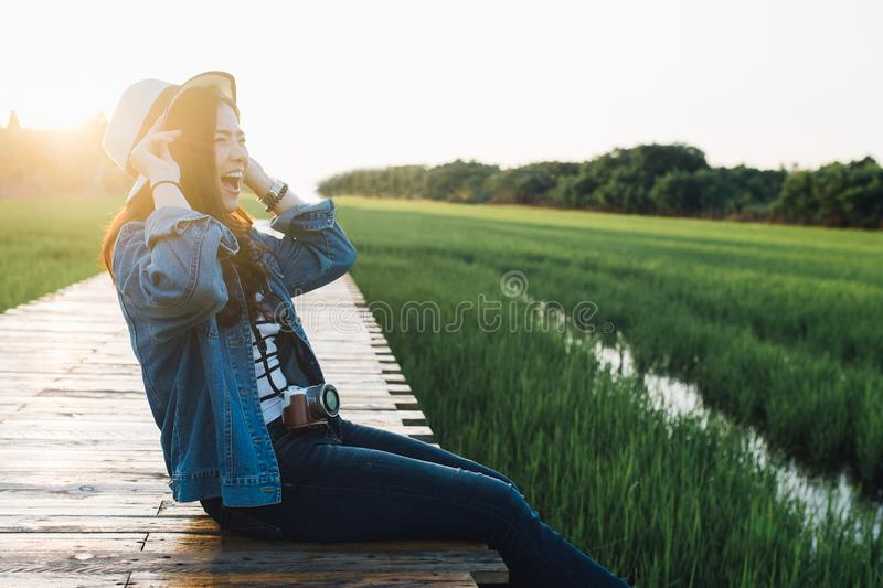Young asian woman smiling in hat. Girl enjoying at beautiful nature with sunset. Travel Summer Holiday Vacation and Relaxation royalty free stock photos