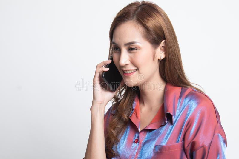 Young Asian woman talking with mobile phone royalty free stock images