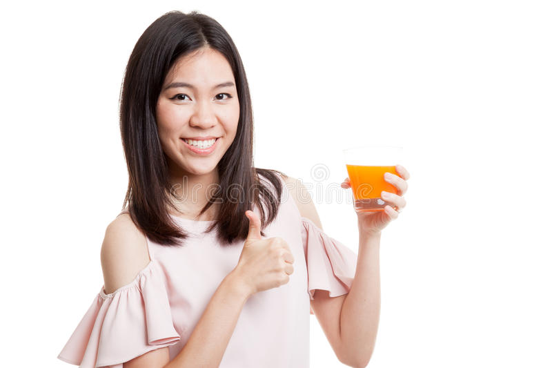 Young Asian woman thumbs up drink orange juice. Young Asian woman thumbs up drink orange juice isolated on white background stock photos