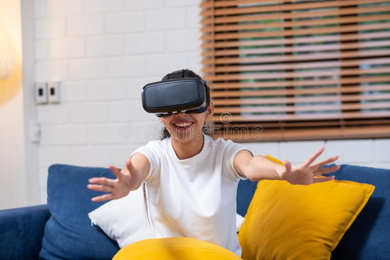 Young asian  woman touching air during the VR reality experience wearing virtual reality goggles .future technology concept stock image