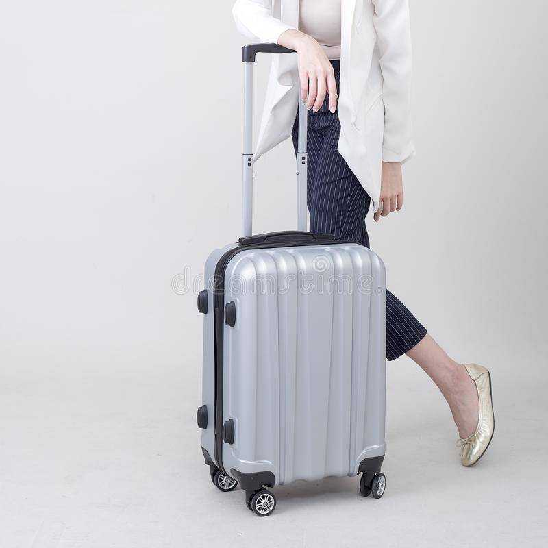Young Asian woman tourist with luggage to travel stock photo