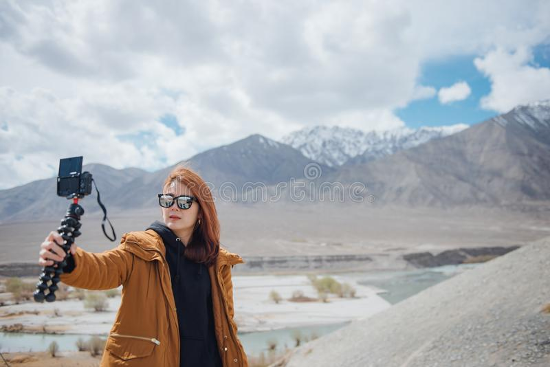 Young asian woman traveler selfie with beautiful mountain. royalty free stock photo