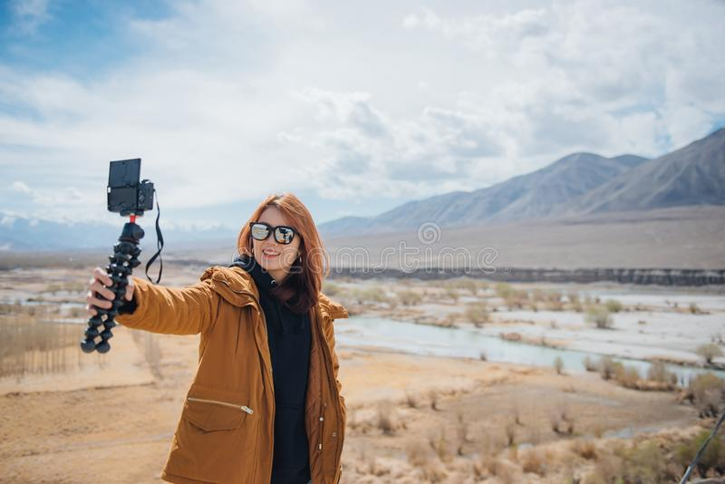 Young asian woman traveler selfie with beautiful mountain between a vacation in leh. royalty free stock photos