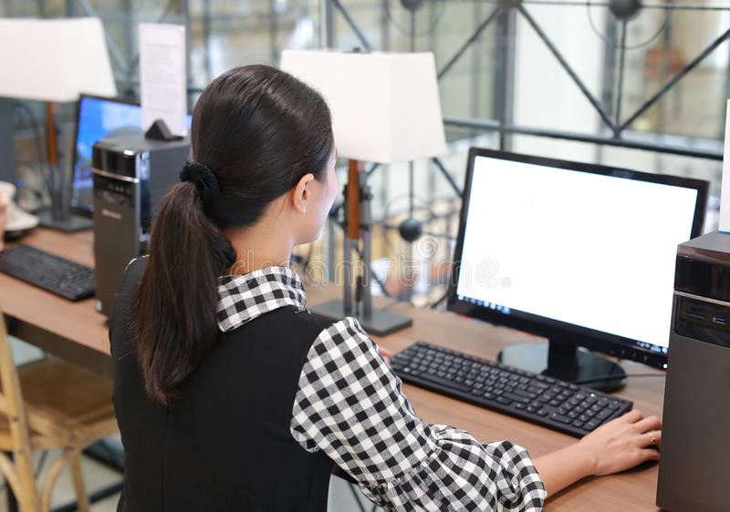 Young asian woman using desktop computer in the library stock photos