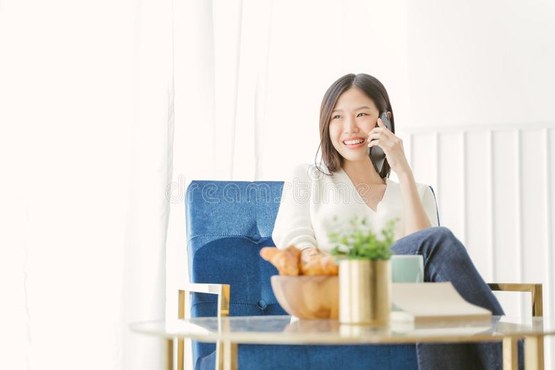 Young Asian woman using phone talking happy and smile. stock image