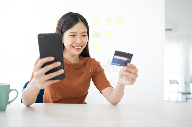 Young Asian woman using smartphone and credit card. Shopping buying online. Young Asian woman using smartphone and credit card. Shopping buying online royalty free stock image