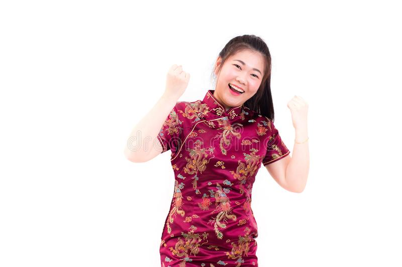 Young asian woman wearing chinese dress traditional cheongsam with gesture of congratulation, stock images