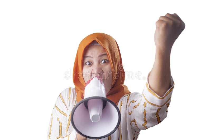 Asian woman Shouting with Megaphone. Young Asian woman wearing hijab shouting with megaphone and pointing to camera. Leader or supporter concept. Close up body stock images