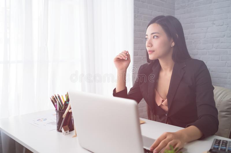 Young Asian woman working royalty free stock image