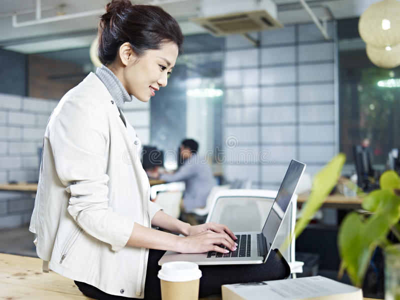 Young asian woman working in office royalty free stock photography