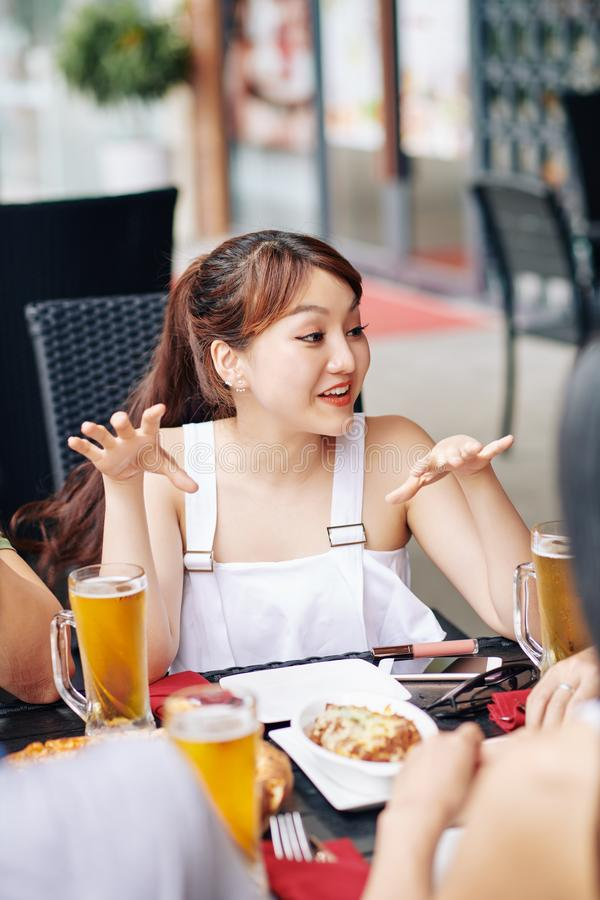 Asian woman with friends in cafe royalty free stock image