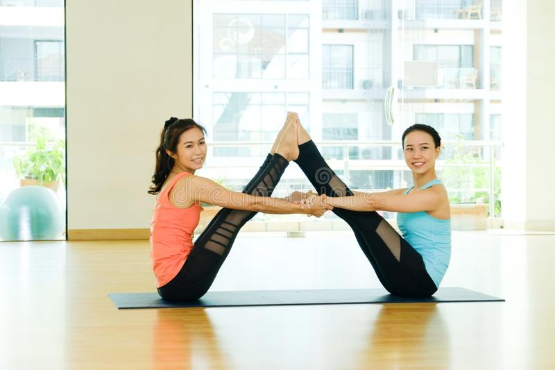 Young asian women practicing yoga meditation, healthy lifestyle, wellness, well being royalty free stock image