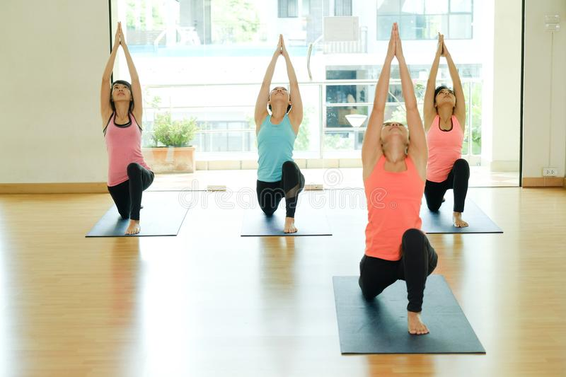 Young asian women practicing yoga meditation, healthy lifestyle, wellness, well being stock photography