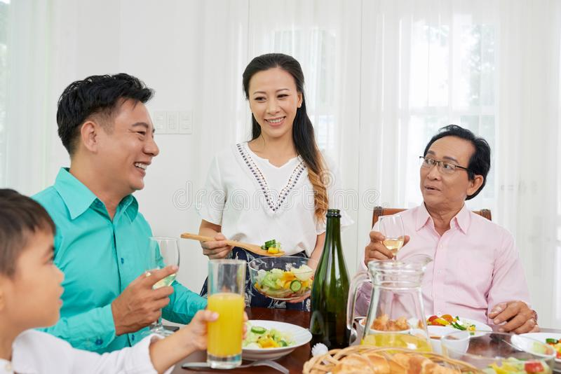 Happy family having meal together royalty free stock photo