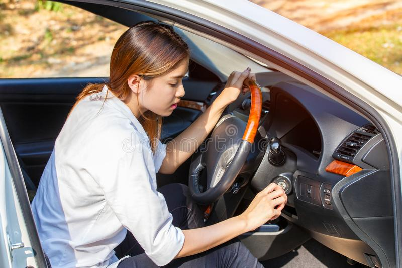 Young asian women starting a car engine with ignition key royalty free stock photos